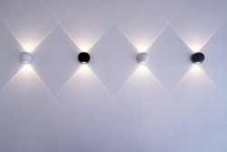Modern wall lamp with beam of light on empty wall. - Modern decoration minimalism for home interior design.
