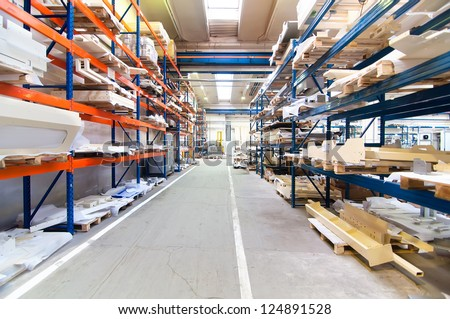 modern warehouse with symmetric rows of shelves interior and colorful shelving system
