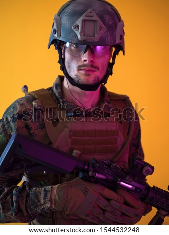 modern warfare marine soldier with fire arm weapon and protective army tactical gear clothes Studio shot on  isolated yellow background #1544532248