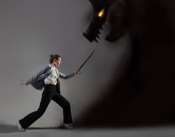 Modern warrior, struggle with external conflicts or internal self-doubt, concept photo art. A young woman in a suit and with a saber fights with a shadow in the form of a beast