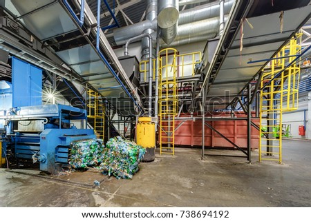 Modern waste recycling processing plant. Separate garbage collection. Recycling and storage of waste for further disposal.