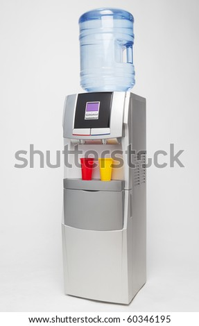 Modern water cooler on blue background with red and yellow plastic cups. With included clipping path.