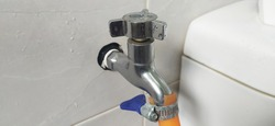 Modern water tap in the toilet of new modern house. Made from steel anti rust. New concept of tap.