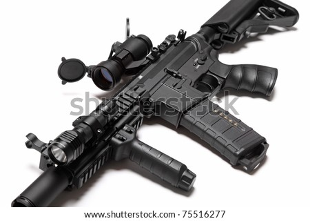 Modern weapon series. US Army Spec Ops M4A1 custom build assault carbine with RIS/RAS, red dot sight and tactical flashlight. Object on a white backgound. Tilt view, shallow DOF. Studio shot.