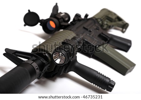 Modern weapon. US Spec Ops M4A1 custom rifle for paramilitary contractors with red dot sight, silencer and tactical flashlight. Object is on white background. Tilt view, shallow DOF. Studio shot.