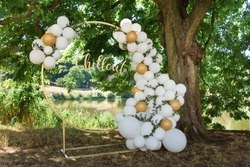 modern wedding arch, inflatable balloons. inscription in gold chillout
