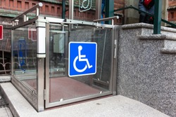 modern wheelchair lift near the building