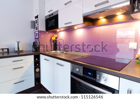 Modern white and purple kitchen interior - stock photo