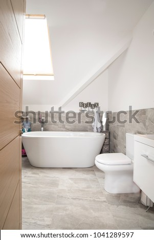 Modern white bathroom suite interior example #1041289597