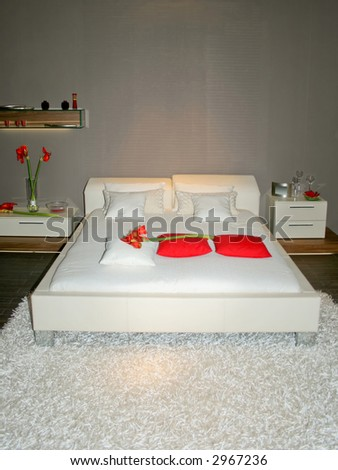 Modern white bed with grey painted wall