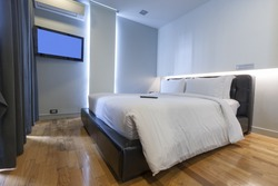 modern white bedroom with air condition and lcd tv.