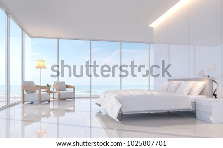 Modern white bedroom with sea view 3d rendering image.There are white tile floor and white glossy wall.Furnished with white furniture.There are large window overlooks to sea view.