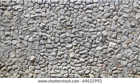 modern white Brick Wall made of fragment stones in irregular shapes