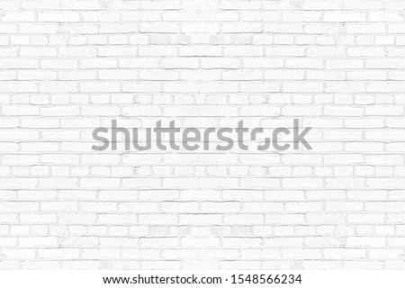 Modern white brick wall texture background for wallpaper and graphic web design.