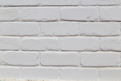 Modern white brick wall texture may used as background or sample for exterior or interior design.Home and office design backdrop. Abstract weathered old stucco, painted loft styled bricks wall pattern