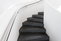 Modern white curved staircase in house, Staircase of black stone, Symbol of modern living, Stairs with handrails in building, Contemporary style living, Symbol of modern home
