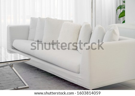 Modern white fabric sofa. Sofa in lounge for relaxation.
