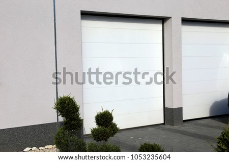 Modern white garage door (sectional door) #1053235604