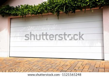 Modern white garage door (sectional door)  #1121565248