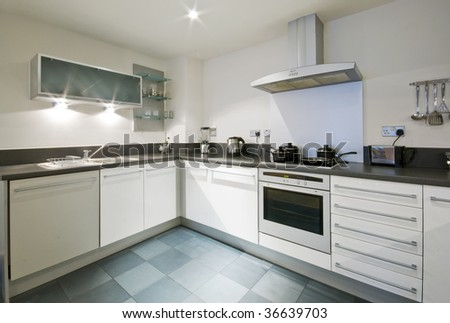 Modern White Kitchen With Kitchen Appliances And Tools