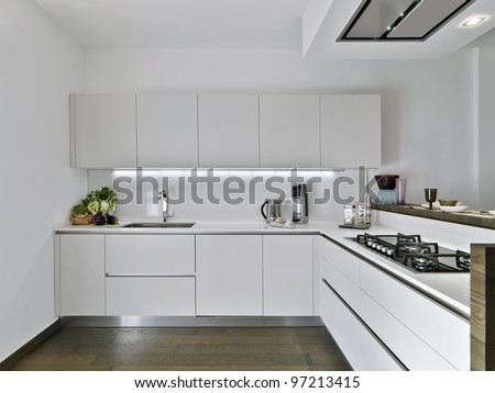 modern white kitchen with wood floor