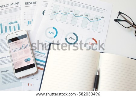 Modern white office desk table with smartphone and other supplies with Business report meeting and briefing.  #582030496