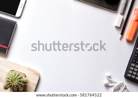 Shutterstock Modern white office work table with smartphone notebook pen and calculator top view