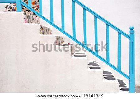 Modern white stair up to the house