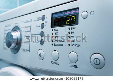 Modern white washing machine front panel with display