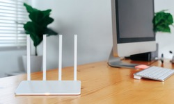 Modern WiFi router on light table in home office