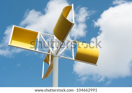 Modern wind turbine made from steel with colorful of yellow under blue sky and white cloud at Osaka, Japan