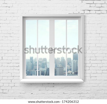 Modern window with skyscraper view in brick wall #174206312