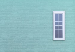 Modern windows and Detail of house exterior blue wall.
