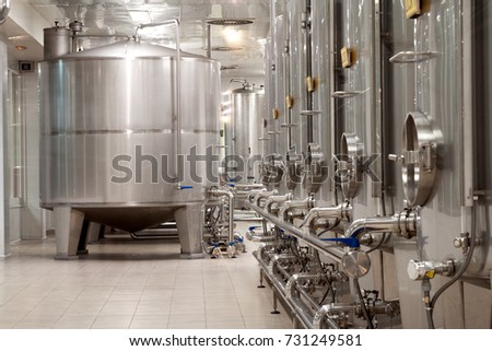 modern wine factory with new large tanks for the fermentation #731249581