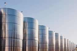 Modern winemaking plant, wine production. Large stainless steel tanks for wine.