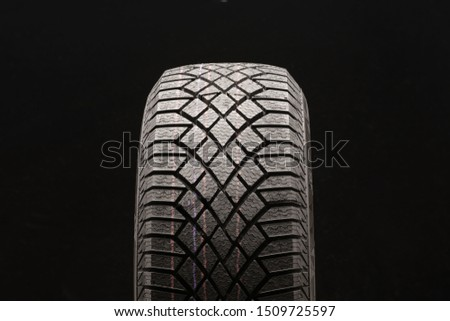 modern winter friction tyres Velcro. safe driving. image wheel on a black background, rubber products, auto parts. front view #1509725597