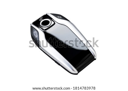 Modern wireless car key ignition isolated on white background. Wireless start engine key. Car key remote isolated over white. Modern car keys. Car keys close up.
