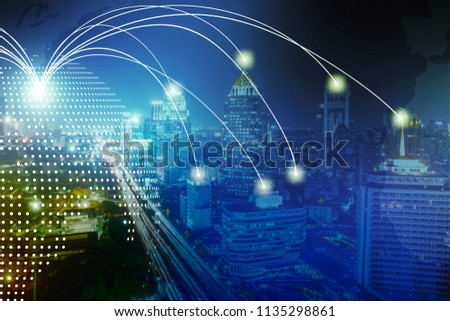 Modern wireless connection technology in smart city. Closeup dots globe with connection lines and dots over high building in business center city at night. #1135298861