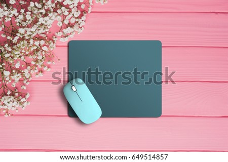 Modern wireless mouse and pad on background #649514857