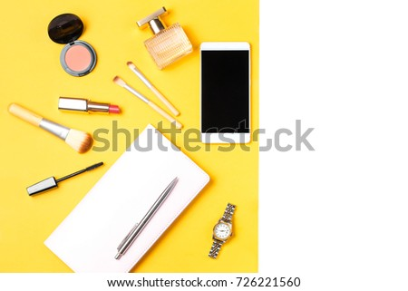 Modern woman accessories. Beauty products, smartphone, note book, accessories on a pastel background #726221560