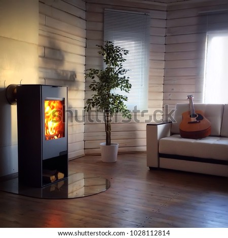 Modern wood burning stove inside cozy living room