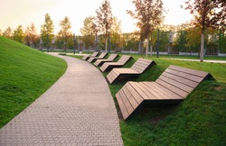 modern wooden benches for relaxing in the Park in the early morning