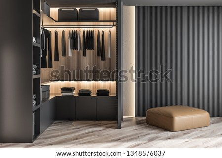 Modern wooden wardrobe with clothes hanging on rail in walk in closet design interior. 3D render Foto stock ©