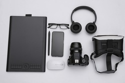 Modern work and entertainment gadgets on white background. Top view. Flat lay