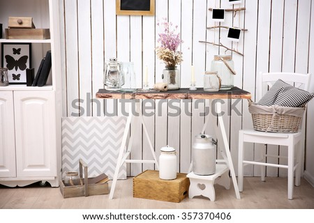 Modern workplace for designer in rustic style, on brick wall background