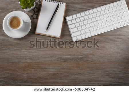 Modern workplace with cup of coffee #608534942