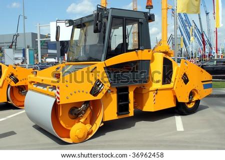 Modern yellow road roller