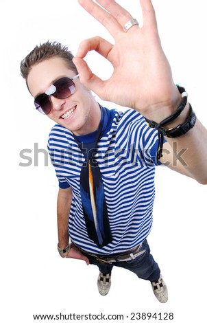 Modern young guy showing okay sign - high angle view - stock photo