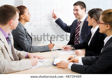 Modern young people at a business meeting - stock photo