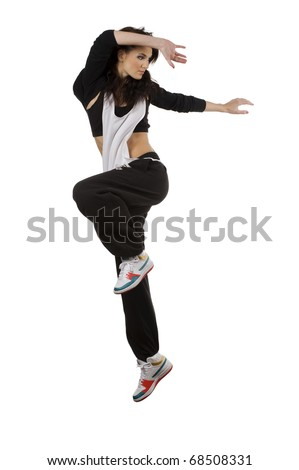 modern young woman dancer in hip hop style taking pose and  jumping over white background